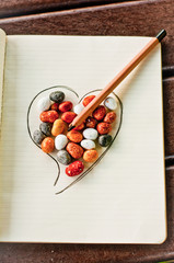 Heart, stones and pencil 1