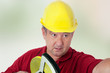 Construction worker with tape measure