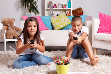 Sister and brother compete for watching TV
