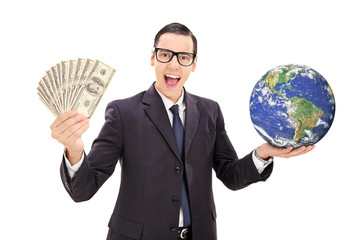 Sucessfull businessman holding the planet