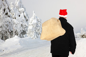 Man with cloth bag runs through the snow