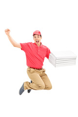 Overjoyed pizza delivery guy jumping