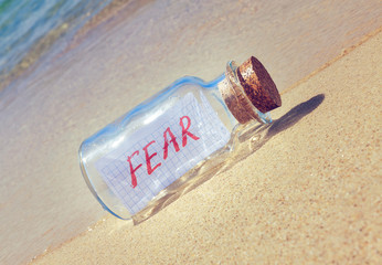 Creative anxiety and fear concept. Bottle with a message