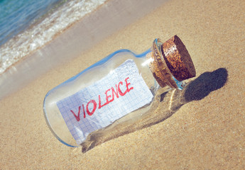 Creative violence concept. Message in a bottle with text