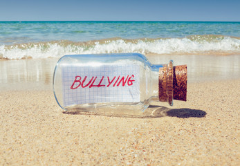 Creative bullying concept. Bottle with a message