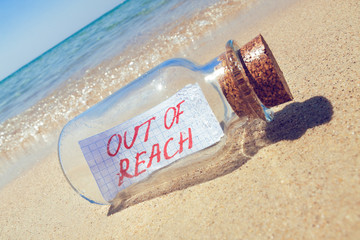 Creative summer break concept. Bottle with a message.