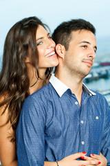 Sensual girl holding boyfriend.