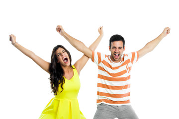 Couple shouting with arms raised.