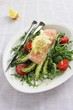 Portion steam salmon with a salad of arugula and fresh asparagus