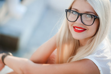 beautiful blond woman in glasses
