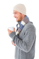 Handsome man in winter fashion holding mug