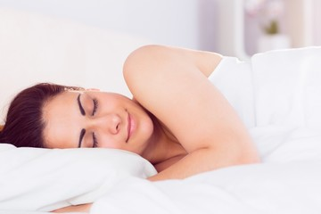 Relaxed beautiful woman sleeping in bed