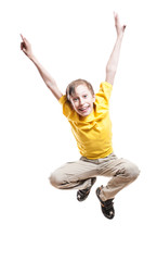 Beautiful funny child in yellow t-shirt jumping and laughing