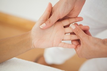 Woman receiving a hand massage