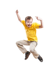 Funny child jumping and laughing pointing with his index finger