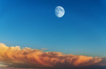 Moon with sunset sky background.
