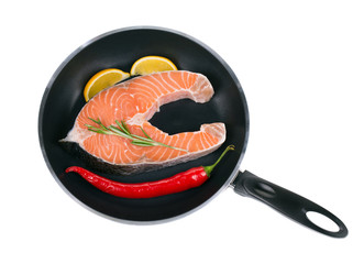 Fresh salmon steak on pan.