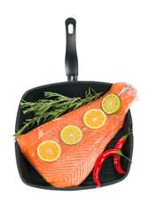 Fresh salmon fillet on a pan.