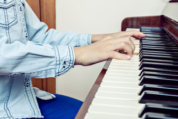 Closeup of child's hands palying piano