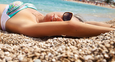 glamourous young woman on the beach