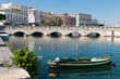View of Umberto I bridge in Siracuse and fishing boats - 69306445
