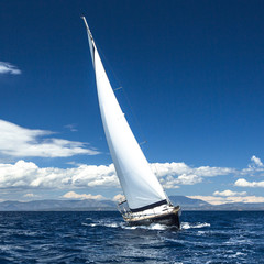 Sailing in the wind through the waves. Luxury yachts..