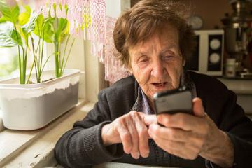 Portrait an elderly woman with smartphone.