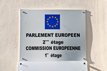 European parliament and commission sign on a wall