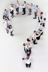 Portrait of business people forming question mark