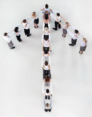Business people forming arrow