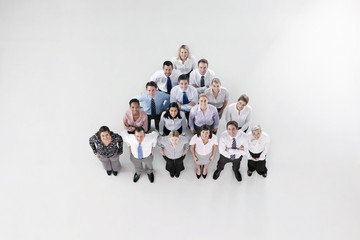 Portrait of smiling co-workers forming pyramid