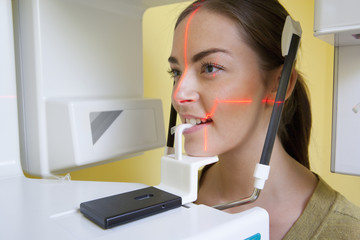 Close up of young woman undergoing dental x-rays