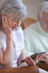 Close up of senior woman using digital tablet