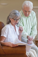 Senior couple discussing paperwork