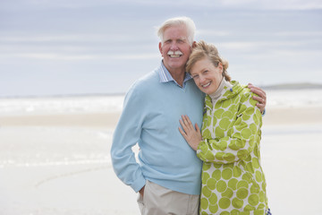 Romantic Mature Couple On Winter Beach Holiday