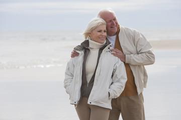 Romantic Mature Couple On Winter Beach Holiday