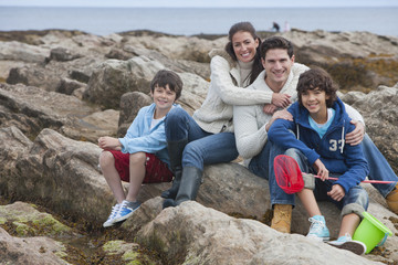 Family Exploring Rockpools Together