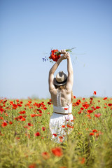 Woman at dress with poppy bouquet