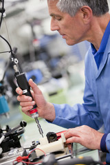 Technician working in hi-tech electronics manufacturing plant