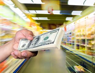 Man holding stack of dollar bills