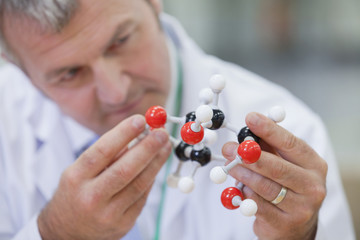 Close up of chemical engineer examining molecular structure