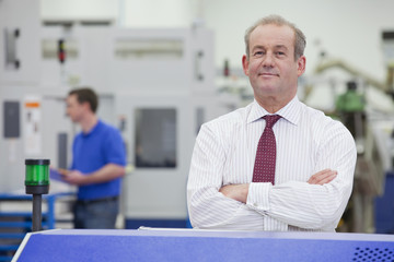 Portrait of confident businessman in hi-tech manufacturing plant