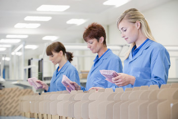 Workers packaging products in manufacturing plant