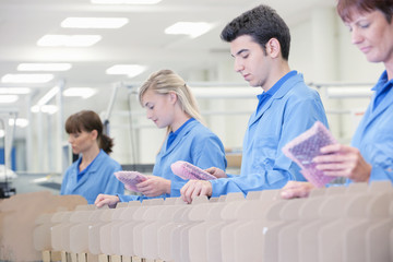 Workers packing products in manufacturing plant