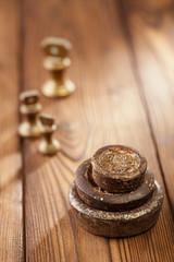Vintage  iron and brass kitchen  weights on wood