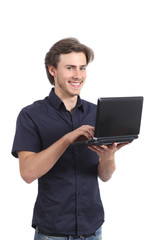 Happy standing man typing on a laptop
