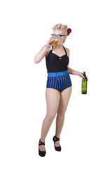 Woman in pin-up dress drinking - Isolated
