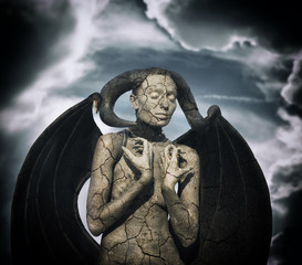 Mystic creature - woman in body paint with wings and horns