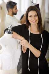 Fashion designer working on garment on mannequin