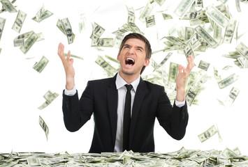 Business man throwing dollar bills and yelling.